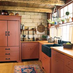 "This ""primitive"" kitchen packs a lot of modern functionality (like the fridge hidden in the cupboard!) (Photo: Gridley + Graves)  