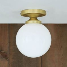 The Mullan Yaounde Semi Flush Fitting will diffuse warm light in your room
