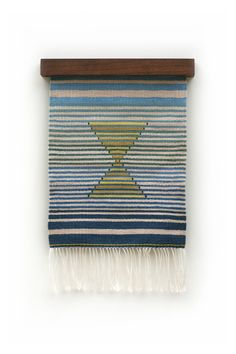 Hourglass Tapestry- Hand woven by the artist in LA, CA. The variations within shades of color were achieved by dyeing different types of fibers in Osage and Indigo, each reacting with the dye differently. materials: linen/cotton/wool/silk natural dye
