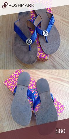 Tory Burch authentic sandal Authentic Tory Burch sandal with gold Tory emblem and navy patent leather straps. Gently used, has marks on sole, other than that good condition! Size 7 Tory Burch Shoes Sandals