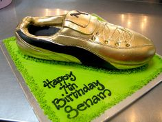 3D Gold & Black Puma Soccer Boot shaped cake by Charly's Bakery, via Flickr