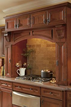 Hearths are available in various sizes and configurations, adding traditional and old-world looks to a design - Shrock Cabinetry Kitchen Hoods, Cozy Kitchen, Kitchen Cabinetry, Kitchen Ideas, Kitchen Things, Kitchen Inspiration, Cabinet Door Styles, Cabinet Doors, Building A Kitchen