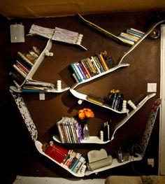 bookshelves made from skateboards