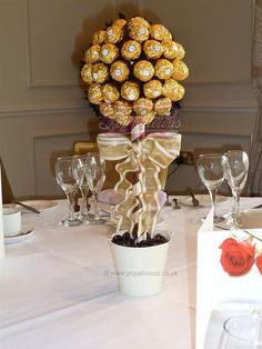 Chocolate (Ferrero Rocher) Topiary Centerpiece I would sooo use these! Candy Topiary, Candy Trees, Chocolate Wrapping, Chocolate Gifts, Topiary Centerpieces, Table Decorations, Centrepieces, Chocolates, Chocolate Flowers Bouquet