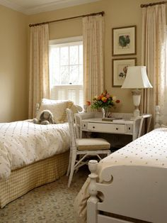 Twin Bed Polka-dotted Bedroom | Soft colors and whimsical fabrics give this young girl's room a feminine touch. A desk can function as a bedside table between twin beds.