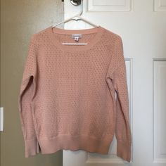 "Calvin Klein Light Pink Sweater Amazing ""holey"" light pink Calvin Klein sweater that was only worn once. Great comfort and amazing wide banding on cuffs and waist Calvin Klein Sweaters Crew & Scoop Necks"