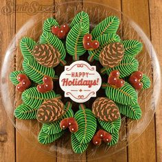 Pine Wreath and Berries decorated Christmas cookie platter! The pine branches were made with feather cookie cutters. #royalicing #icedbiscuits