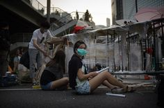 Umbrella Revolution Hong Kong, A pro-democracy protester puts the finishing touches on a new barricade in the Admiralty district of Hong Kong on October 13, 2014. Hong Kong police started removing street barricades at sites where pro-democracy demonstrators have been holding more than two weeks of rallies, paralysing parts of the Chinese financial hub. AFP PHOTO / Ed JONES (Photo credit should read ED JONES/AFP/Getty Images)