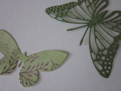 3D paper butterfly wall art in tropical green and matching design paper --- A set with a tropical feel for a natural touch in any decor. €16,95, via Etsy.