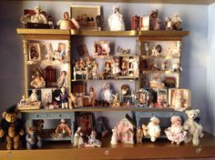 My 20 year collection of tiny dolls and toys in a cabinet made from a kit by Lisa Engler