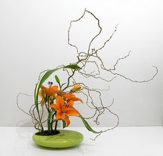 Aspidistra leaves Curly Willow branches and Asiatic  Lillies ,