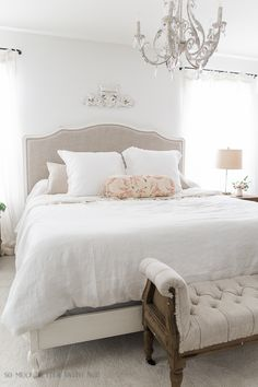 This bedroom is so light and bright and airy and is totally French vintage with the curvy furniture, chandelier and antique armoire. A must see!