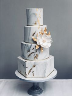 A 4 tier, grey marbled cake with edible gold leaf and a beautiful open peony. 4 Tier Wedding Cake, Fall Wedding Cakes, Beautiful Wedding Cakes, Wedding Cake Designs, Beautiful Cakes, Elegant Wedding Cakes, Gold Leaf Cakes, Edible Gold Leaf, Silver Cake