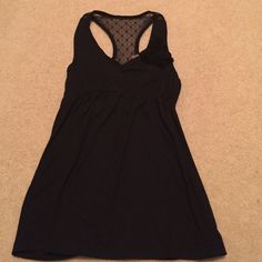 Black Tank Top This top has a great flower accent and a lace accent on the back! Eyeshadow Tops Tank Tops