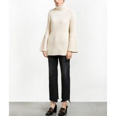 """- """"I'm revamping my knitwear collection and this bell-sleeve turtleneck is anidealsilhouette for maximumversatility. I can wear it with slim trousers and a heeled loafer at work, over a fitted skirt withheels for date night or with straight-leg jeans and ankle boots to gothe off-duty route.""""—Laura Lajiness, Fashion EditorPixie Market Bell-Sleeve Turtleneck Sweater, $95"""
