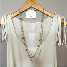 NWT Gold Layered Necklace. NWT Gold Layered Necklace. icing Jewelry Necklaces