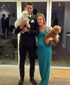 Oh this is killer adorable. Novak Djokovic and his wife Jelena Ristic-Djovokic with their doggies. I can't.