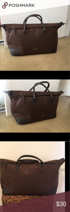 Hugo Boss Brown Travel Tote- Brand New Hugo Boss Brown Travel Tote- Brand New without Tags- brown felt fabric- Faux leather details and handles. Hugo Boss Bags Luggage & Travel Bags