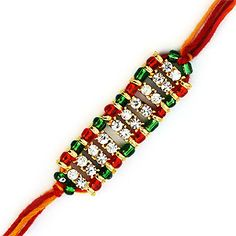 A Charming colorful diamond creation with glass beads.  This rakhi is designed in the way of express of your hearts expressions.  This is a diamond beaded rakhi adorned with multi glass color beads gives precious look to the rakhi.   The mauli threads with red glass beads is a combination of splendar design.