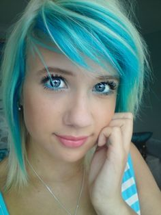 Various shades of blue on hair (aqua, light blue, blue).  Makes look like the blond hair is highlighting blue hair.  Cute hairstyle on this girl as she has matched heir eye liner color, and she already has blue eyes to match. :) She could have also done a matching blue eyelash color.
