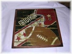 Gridiron Wooden Football Sports Sign Boys Bedroom Art by The Little Store of Home Decor, http://www.amazon.com/dp/B00640UXQG/ref=cm_sw_r_pi_dp_n8sWrb06YYV26