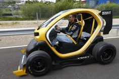 Formula One driver Sebastian Vettel of Germany steers a new Renault Twizy Sport car at Renault test center outside Boulogne-Billancourt, near Paris. Sport F1, Sport Cars, New Renault, Kei Car, Drift Trike, City Car, Pedal Cars, Modified Cars, Small Cars