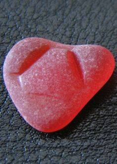 Rare red sea glass from Canada... I NEED to find a piece of this someday...