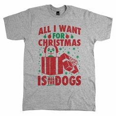 """Say hello to the adorable pup sneaking out of a gift box on our sweet """"All I Want for Christmas is All the Dogs"""" apparel. Makes the paw-fect paw-liday gift."""