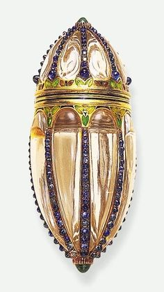 AN EXCEPTIONAL ROCK CRYSTAL AND GEM-SET SCENT BOTTLE, BY BOUCHERON. Designed as…