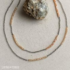 Gorgeous elegant long silver crystal beaded gem necklace. Tan crystal beads on silver chain. One of a kind, designed by Lavish Three.  Would make a great Valentine's or Mothers day gift for her! Check out our exclusive line of unique one of kind necklaces and bracelets.