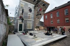 """Leandro Erlich """"Dalston House"""".  I like how this invites people to play and be a part of this optical illusion! Look at that guy hanging!!"""