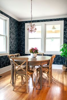 Lovely dining room featuring Garden (Noir) wallpaper. And it's in the home of Karla Pruitt who designed the pattern!