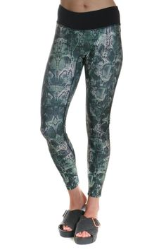 These PrismSport Reptile Leggings are equally as good from a workout to street style doubling their wardrobe potential! A super stretch fabrication is made up in an emerald hued snake print for a trendy and fashion forward feel. Let your style standout!   Snake Print Legging by PrismSport. Clothing - Bottoms - Pants & Leggings - Leggings New York... - Total Street Style Looks And Fashion Outfit Ideas