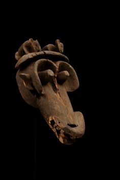 mask  Materials wood  Place of collecting Cameroon  Culture Bamum  Dimensions 21,3 cm x 54,2  cm