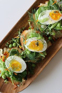 Egg and Pea Crostini with dill, watercress, creme fraiche, green onions & micro greens