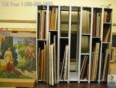 Rolling art storage racks and hanging framed artwork shelving protects artwork from damage and saves valuable floorspace in museums and other art gallery facilities.