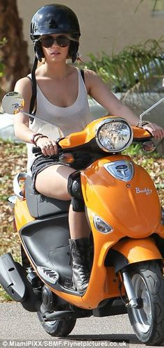 """Ashley Benson on a Genuine """"Buddy"""" scooter in """"Spring Breakers""""."""