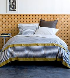 Woven wood veneer strips from Lowe's and a staple gun to make a woven wood headboard.  Readily adapt to other weavable materials like canvas tape.