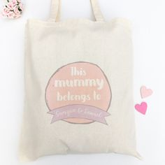 A stylish and practical tote bag with the wording this mummy belongs to and the names of her children. The wording can be changed to mum, mother or a nickname of your choice. A perfect personalised gift for Mothers Day. The bag measures 42 x 38cm, and the handles are 33cm from the top of the bag to the top of the handle making them longer enough to fit comfortably on your shoulder. They are strong and durable made from 4 oz cotton.