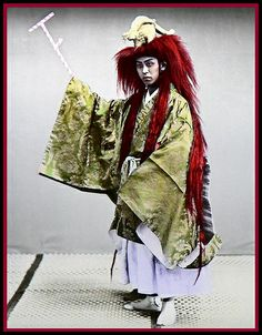"about 120 to 130 years ago !    Love the head-dress. Simply beautiful.    Great studio shot of an Actor doing his thing in old Japan. HisuiJADE from Japan:""""I think this is a costume for Noh . The red wig called Akagashira (, red head/hair) is worn for the role of Oni (,demon), Dragon God  and Shojo ( red drunk monkey-like monster/spirit). The headdress is Ryudai . And the appetizing PEPPERMINT STICK is Uchizue  that is a property as a weapon/wand (magical powers) of Oni and Dragon God. :)"