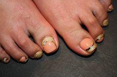 Orange toe nails
