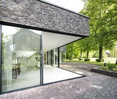 Villa Bloemendaal 1 is located in the luscious green surrounding of Park Brederode. Brick Architecture, Interior Architecture, Mid Century Exterior, House Cladding, Brick Facade, House Extensions, Glass House, Modern House Design, Interior Design Living Room