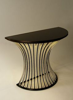 Luxe console table Phlillips & Woods - Console table in bronze with crystal beads and black lacobel glass top. Lit underneath with LED strip. ➤ For more inspirational ideas take a look at: www.modernconsoletables.net #consoletables #homedecorideas #luxuryhomes