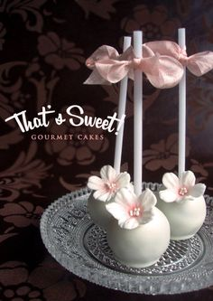 White Cake Pops with Pink Tinted White Flowers and Pink Bow