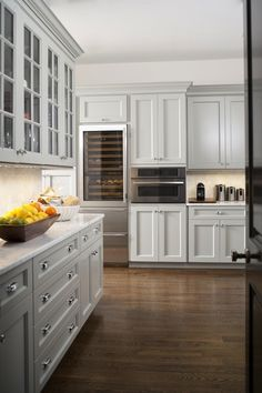 Light gray cabinets, darker flooring