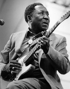 American blues musician and singer Muddy Waters (1913 - 1983) in concert, circa 1970.