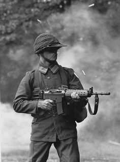 A Swedish soldier firing the then, newly issued (FN FNC) on full auto
