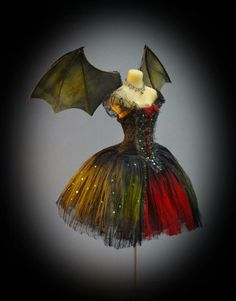 """whengothgoesbrown: """" Bat Winged Corset Gown. """""""