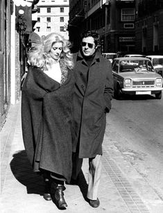 Catherine Deneuve & Marcello Mastroianni; uncluttered, monochromatic look: mac coat, turtleneck sweater, dark shades