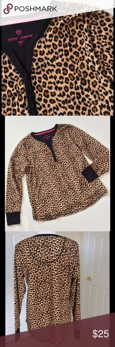 """Listing Betsey Johnson Leopard Lounge Top NWOT Soft, velvety feeling fabric in a pretty leopard print with black knit cuffs & neckline. New Never worn. No tags. 53% cotton 47% polyester. Machine wash. 43"""" bust 42"""" waist 44"""" hip length from shoulder 26"""" Bundle discount  ⭐️5 star rated Suggested User Smoke free home No trades please   Thank you for shopping with me. Please ask all questions before purchase Betsey Johnson Tops"""